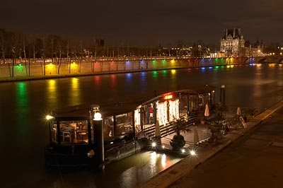 Houseboat with Louvre in the background and Olympic lighting